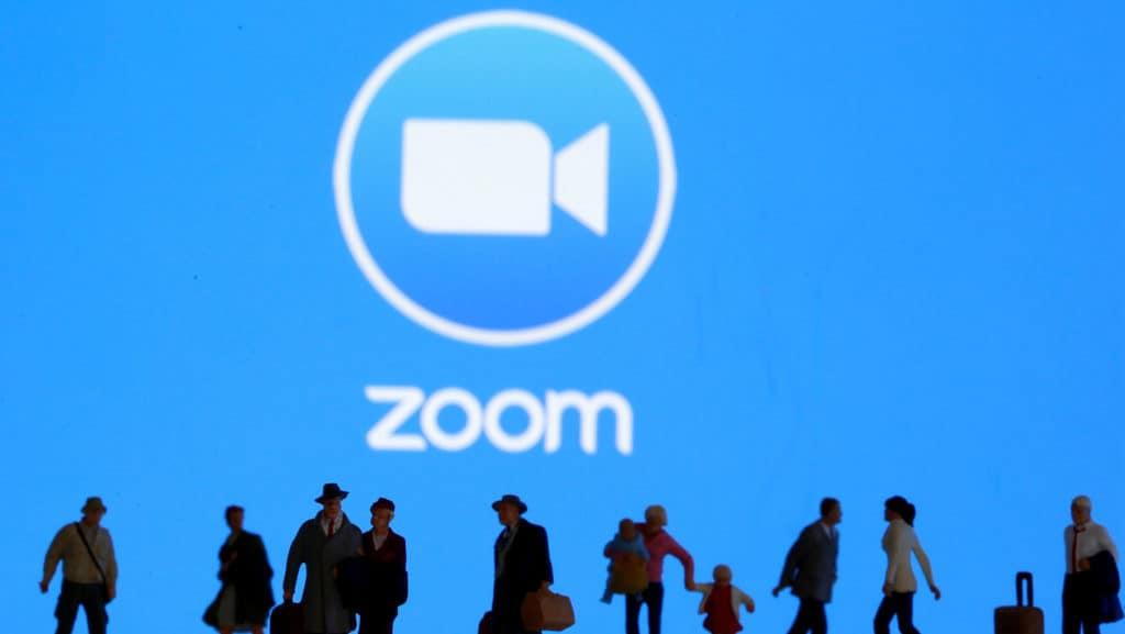 Zoom logo behind people